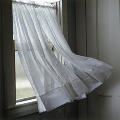 Wind blowing a curtain on a window - Royalty Free Images, Photos and Stock Photography :: Inmagine