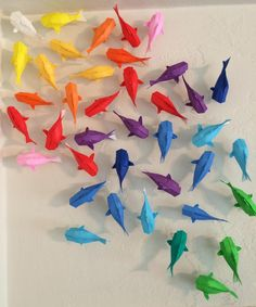 Wall Of Rainbow Koi  •  Free tutorial with pictures on how to fold an origami animal in 18 steps