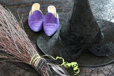 Create a Wicked Witch of the West costume complete with a hat and broom by combining several black clothing items found at a thrift store.