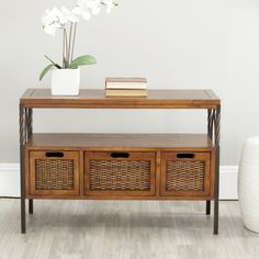 The dark walnut antique console table gets its good looks from the tasteful combination of wood, natural iron, and wicker. Three sturdy wood framed drawers with wicker sides and shelf make for great storage while adding to the style of your home.