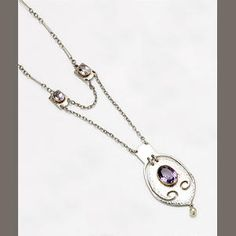 Murrle Bennett & Co.  an Amethyst and Pearl Pendant Necklace  the oval mount with planished finish and pierced scroll border, set to the centre with an oval-cut amethyst, with square panel surmount and seed pearl drop, suspended from a fancy-link chain with two similar rectangular panel dividers, and ring and toggle clasp