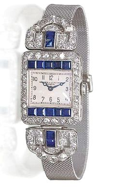 AN ART DECO SAPPHIRE AND DIAMOND WRISTWATCH, BY VACHERON & CONSTANTIN With jewelled lever movement, the cream dial with Arabic numerals enclosed in a calibré-cut sapphire and old European-cut diamond rectangular bezel to the diamond and sapphire palmette shoulders, mesh bracelet and deployant buckle, circa 1920, 14.0 cm. Dial and movement signed Vacheron & Constantin, movement no. 406551