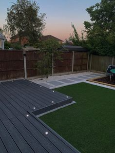Our recent garden makeover with grey composite decking with LED insert lights, astro turf and marble slabs Back Garden Design, Modern Garden Design, Backyard Garden Design, Modern Design, Small Back Garden Ideas, Patio Deck Designs, Patio Design, Astro Turf Garden, Garden Turf
