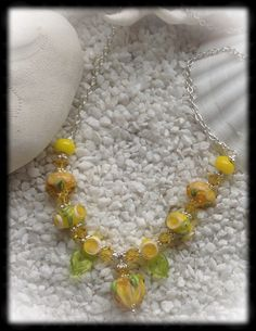 Handmade necklace by torill-k  with lampwork from CCdesign, swarovski crystals and Sterling silver.