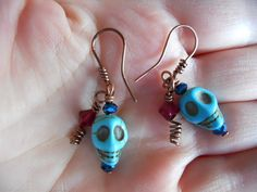 Turquoise Skull Crystal bead Earrings Wire Wrapped by OurBackYard, $10.00