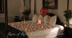 Hotel room decorated with 4 sets of 1 dozen roses, 20 flickering LED candles, 400 red silk rose petals and an assortment of other romantic, decorative items (by Creative Romantic Gifts)