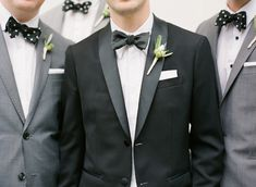 Tux for the groom and gray suits for the guys
