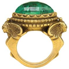 """An antique Egyptian Revival poison ring, surmounted by a faceted lozenge-shaped emerald and flanked by stylized sphinxes, in gold. Marcus & Co. Pictured in """"Rings - Jewelry of Power, Love and Loyalty"""" by Diana Scarisbrick, p. Gold Rings Jewelry, Emerald Jewelry, Pandora Jewelry, Boho Jewelry, Fine Jewelry, Women Jewelry, Gold Jewellery, Emerald Rings, Key Jewelry"""