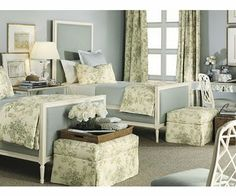 footstools would be nice in a guest room, a place to put your suitcase - love the colors and toile in this room!