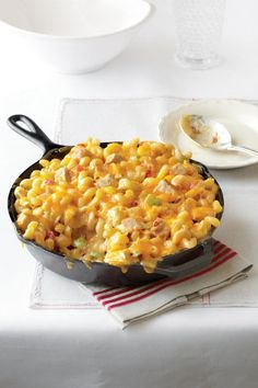 King Ranch Chicken Mac and Cheese - Easy One-Dish Dinners - Southernliving. Recipe: King Ranch Chicken Mac and Cheese Mac And Cheese Casserole, Chicken Casserole, Casserole Recipes, Chicken Soup, Rotisserie Chicken, Fried Chicken, Pizza Casserole, Pesto Chicken, Recipes With Velveeta Cheese