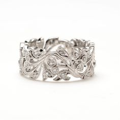 This bold vine scroll ring combines nature-inspired shapes with pave diamonds and fine milgrain. Perfect for wearing as a wedding band or on a night out.