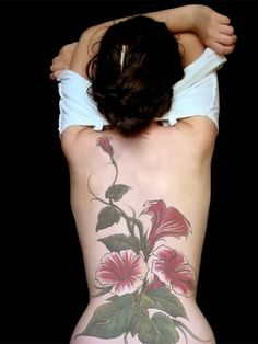 Google Image Result for http://awalltrend.com/wp-content/uploads/2012/02/Flower-Tattoo-Designs-for-Women-2.jpg