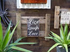Live laugh love dark background tin sign bolted to rustic recyled timber frame.  Frame measures 45cm x 55cm. Suitable for both inside and outside areas...... $60 see our website to order www.newagerusticdesigns.com.au or  email newagerustic@gmail.com or  sms 0418-315-890