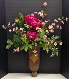 Spring Season 2014 Wall Hanging: Magenta Peonies and light pink cherry blossoms with Ivy filled copper wall planter. Design and Arrangement by http://nfmdesign.synthasite.com/