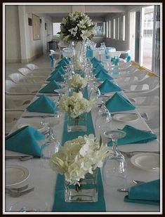 Simple pops of color - table runner, napkins, and add a colored chair sash for a beachside reception.