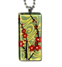 red blossoms on sage necklace pendant - glass and Japanese chiyogami - flowing cherry blossoms. $14.00, via Etsy.