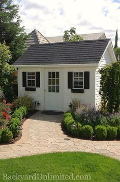 10'x12' Garden Shed with Vinyl Siding, Prehung 9-Lite Fiberglass Door, Flower Boxes, and Rubber Slate Roof http://www.backyardunlimited.com/sheds/garden-sheds
