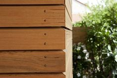 Horizontal tongue and groove natural timber, mitered corner detail (western red cedar?)