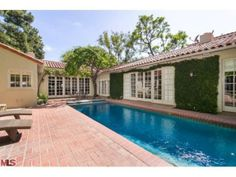 Jodie Foster Relists Private Hollywood Hills Home | Love the Lap Pool and the tile roofs and brick patio... Super charming!