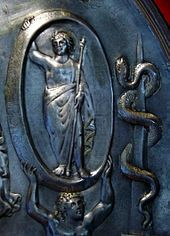 Aion (deity) Detail from the Parabiago plate depicting Aion; Tellus (not shown) appears at the bottom of the plate, which centers on the chariot of Cybele