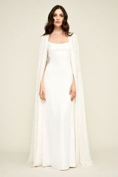 David's Bridal has beautiful plus size wedding dresses that come in a variety of sizes & full figured styles for an affordable price. Slip Wedding Dress, Western Wedding Dresses, Perfect Wedding Dress, Bridal Dresses, Wedding Gowns, Wedding Cape, Gothic Wedding, Wedding Dresses With Cape, Lace Wedding
