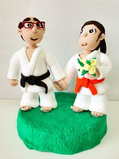 Novios judokas jumping clay
