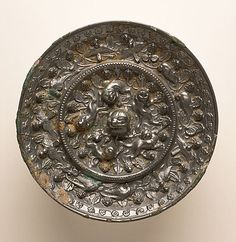 China  Mirror (Jing) with Grapevines, Birds, and Lions, Middle Tang dynasty, about 700-800  Metalwork; bronze, Cast bronze