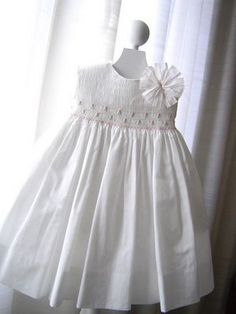 These smocked girls' dresses by Anna Fabo are something else--talk about wedding perfect! The fun pinwheel pins, the intricate embroidery,. Girls Smocked Dresses, Little Girl Dresses, Flower Girl Dresses, Simple Dresses, Cute Dresses, Beautiful Dresses, Princess Outfits, Girl Outfits, Punto Smok