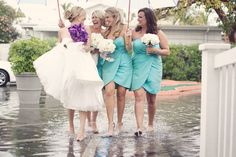 When it rains on your wedding day, play in the puddles with your best friends!