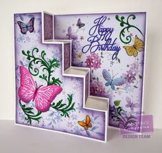 Designed by Jodi Clark for @Crafter's Companion US. Sara Davies Signature Collection Butterfly Lullaby range. Butterfly Lullaby 12x12 paper pad, 6x6 paper pad, Happy Birthday die, Fancy Flourishes die, Butterfly Dance die, small butterflies from Just For You stamp set. Big Score scoring board used for card base scoring and folding.