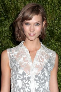 This cool Light Brown haircolor on Karlie Kloss complements her pink skin tone for a very flattering effect. Get your own perfect #hair #color at home here: http://www.haircolorforwomen.com/breakthrough-hair-color-system-your-salon-doesnt-want-you-to-know-about-p/
