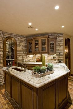 Basement bar....Hmm something like this might work in our basement.  Especially if we make a larger overhang for LOTS of stools!