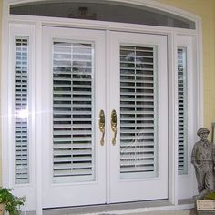 Are your neighbors peeking in your front door or is your furniture or flooring fading from the sun?  French doors look fabulous covered with plantation shutters.  #doors #windowtreatments #summertime #plantationshutters