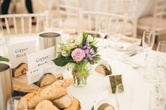 Wood name place settings - Image by Whole Picture Weddings - Bride wears a lace wedding dress to a rustic wedding in Wales in a Marquee at home. Green colour scheme and bespoke bridesmaid dresses, with Landrover's & a pick-up truck as transport.