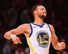Stephen Curry of the Golden State Warriors reacts to his second consecutive three pointer during overtime in a 127123 win over the Los Angeles Lakers...