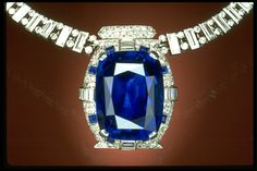 The 98.6-carat deep blue sapphire in a diamond and platinum necklace was designed by Cartier and was found in Sri Lanka. The piece was a gift to the Smithsonian Institute by Countess Mona von Bismark in 1967.