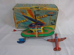 Lot 203 - Vintage tin plate boxed hand controlled stunt plane