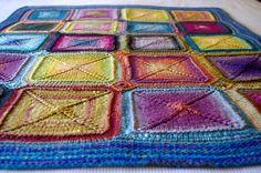 Mystery Blanket (pattern by Elizabeth Zimmermann) knit in Noro Kureyon.
