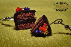 Chocolate Cake  Wild blueberries, cranberries,strawberry and a real leaf of gold making this special belgium chocolate cake pieces, containing 70% of the best cocoa quality!!! The chocolate cake earrings are hanging on a silver plated earring hooks. Cake is approx 1,5 x 1,5cm.