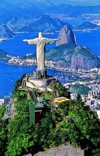 Rio de Janero, Brazil and Corcovado Mountain. Rio around carnival time is one party you need to experience in life.  A memory that will definately last a lifetime !!
