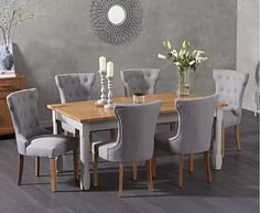 Make your dining area a comfortable and stylish place to be with the Somerset Oak and Grey Extending Dining Table with Camille Grey Fabric Chairs. Combining an extending painted table with upholstered chairs, this set seats Fabric Dining Room Chairs, Modern Grey Kitchen, Grey Dining Room, Modern Grey Dining Room, Oak Dining Furniture, Grey Upholstered Dining Chairs, Grey Dining Tables, Dinning Chairs, Extendable Dining Table