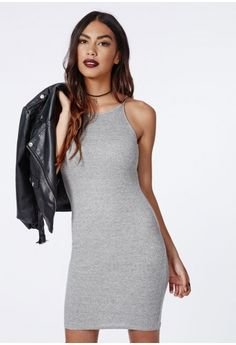 Channel major 90's vibes this season with this high neck ribbed midi dress. This fierce grey dress with bodycon fit will definitely give you a killer silhouette. Team with faux leather pumps and leather biker for effortless off duty style...