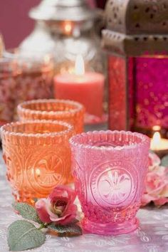 orange and pink glass candle holders with tea light candles