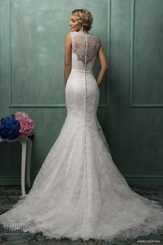 White lace, floral wedding dress.. The buttons all the way down the back are killing me. I NEED IT