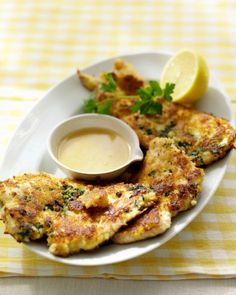 Parmesan-Crusted Chicken - Fresh breadcrumbs and Parmesan cheese form the crispy coating on chicken breast cutlets. A quick lemon and Dijon mustard sauce is drizzled over the chicken just before serving.