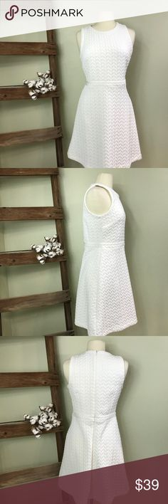 LOFT Quilted Skirt Dress In Whisper White LOFT Quilted Skirt Dress In Whisper White. Quilted stitching gives this soft beauty a textured twist. Features all-over quilted texture, jewel neckline, fit and flare silhouette and back zip closure. Can be dressed up or down! Smoke free home. LOFT Dresses