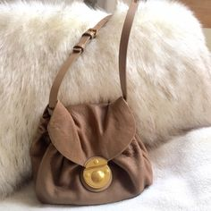 Perfect summertime going out Marc Jacobs purse! Taupe with gold hardware, Marc Jacobs, adjustable strap, perfect for summer! Marc Jacobs Bags Crossbody Bags