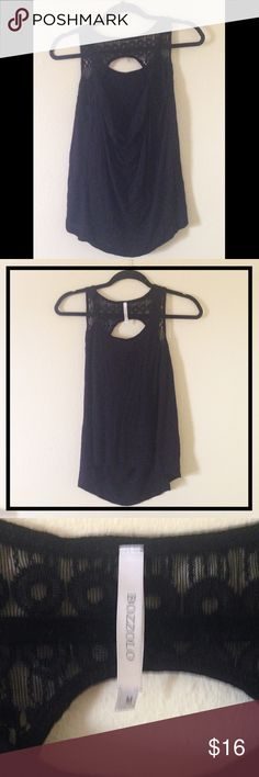 Flowy Open scoop back tank with lace straps This flow, open back tank can easily be dressed up or down and is super flattering! Great for work or going out! In good condition, very soft and comfortable! Bozzolo Tops Tank Tops