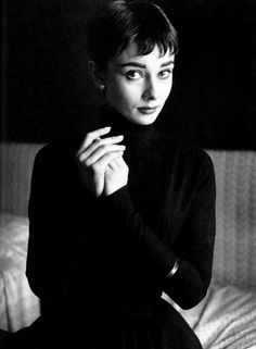Audrey Hepburn with cupped hands.