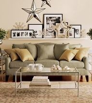 formal living room - like the look of long shelf and frames - easy way to dress up a plain wall.